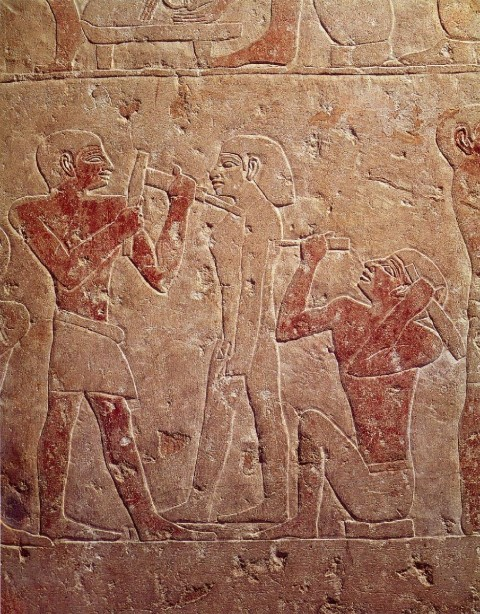 Relief depicting two sculptors carving a statue, from the mastaba of Kaemrehu, Saqqara, Old Kingdom, c.2325 BC. Painted limestone.