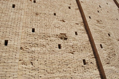 "Detail of ""weeper holes"" at the Ziggurat of Ur. Other holes and damaged areas of the reconstructed ziggurat wall result, in part, from an attack on a nearby Iraqi air base in 1920s (see source)."